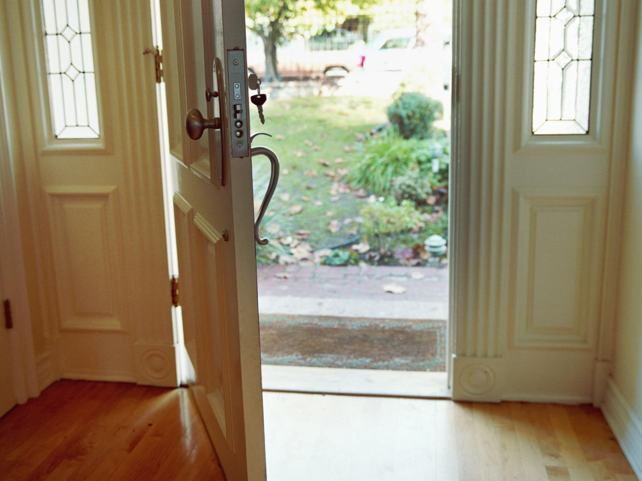 The open front door to your data announcing a white for Entry door with window that opens